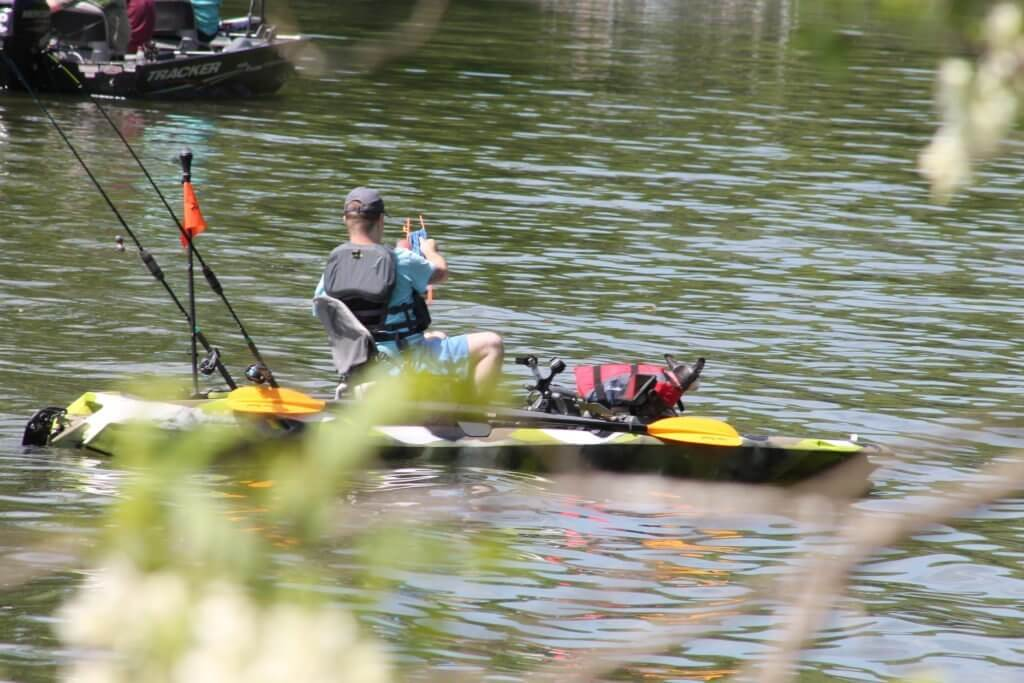 Michael Bourg on the Green Camo FeelFree Dorado 125 Kayak.  Fishing for catfish with his dog Charlie.  The Feelfree Dorado is a very stable kayak that allows for a lot of options.